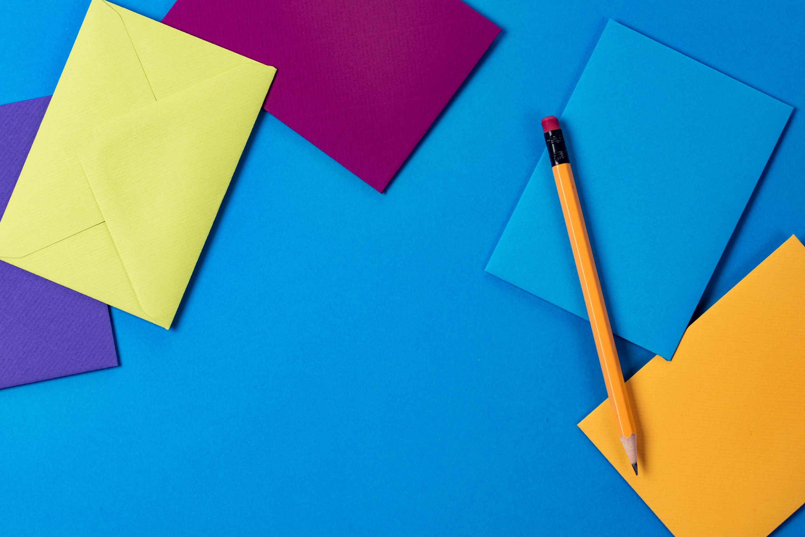 colorful-envelopes-and-pencil